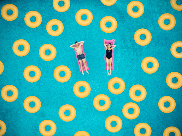 Couplen on ring in swimming pool stock photo
