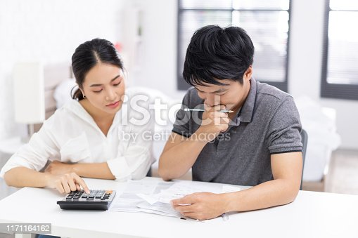 Couples are calculating expenses and bills.the are stress
