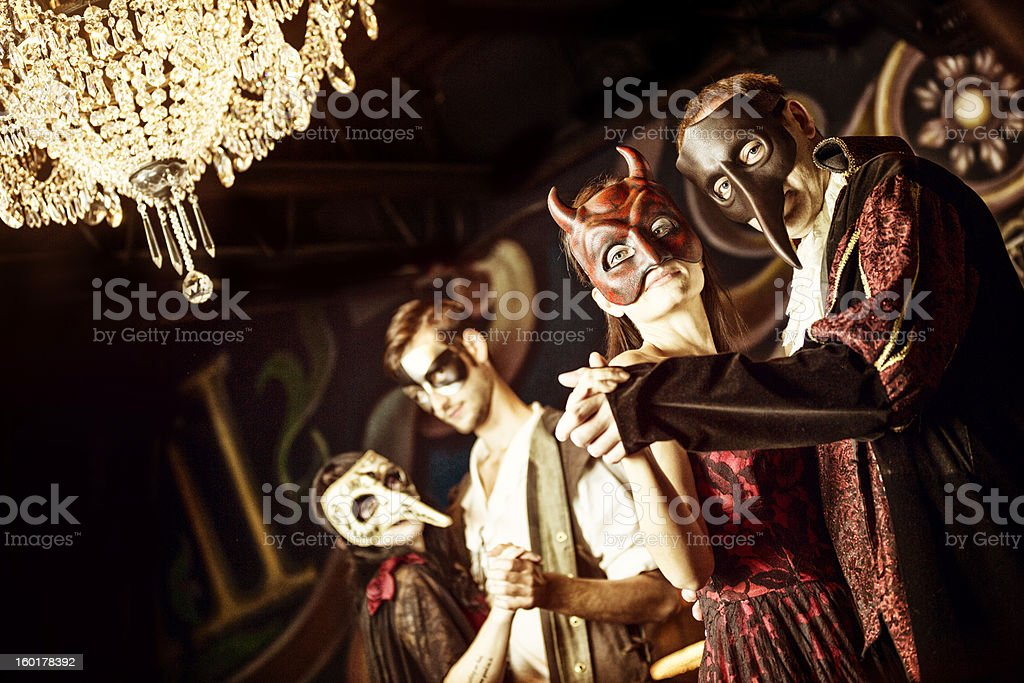 Couples at the masquerade ball stock photo