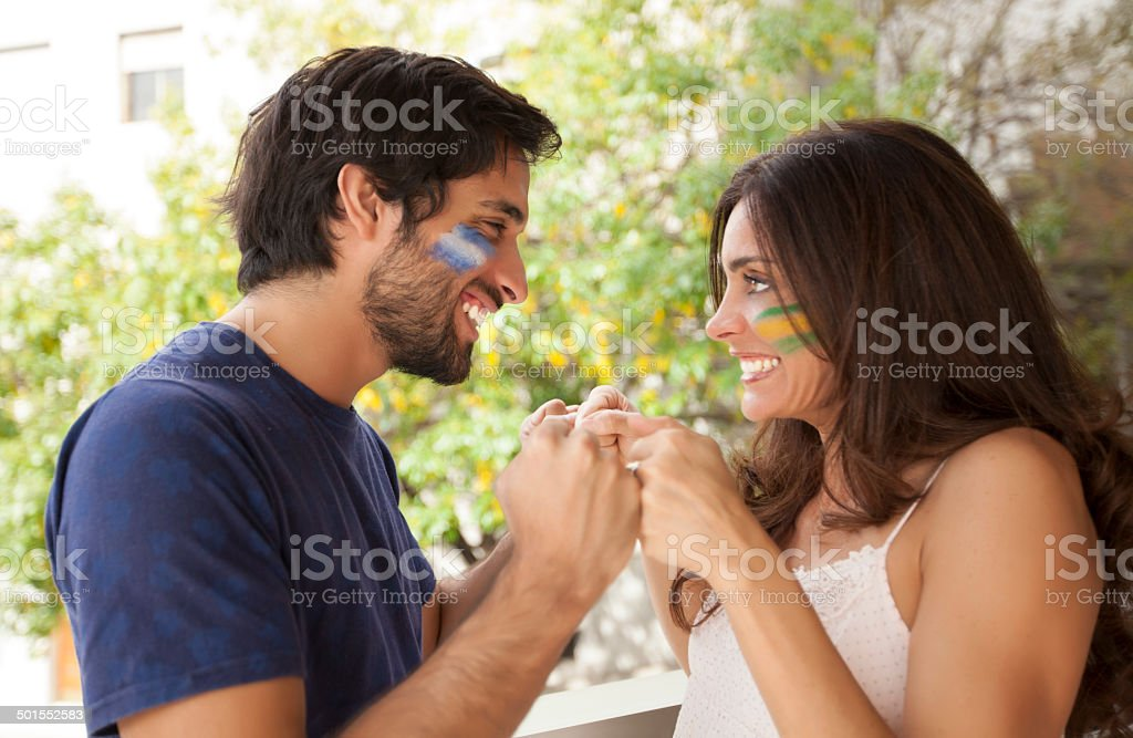 Couples celebrating watching the game stock photo