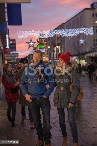817549606 istock photo Couples Christmas Shopping 817552034