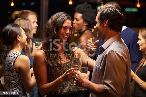 istock Couples Dancing And Drinking At Evening Party 505963814