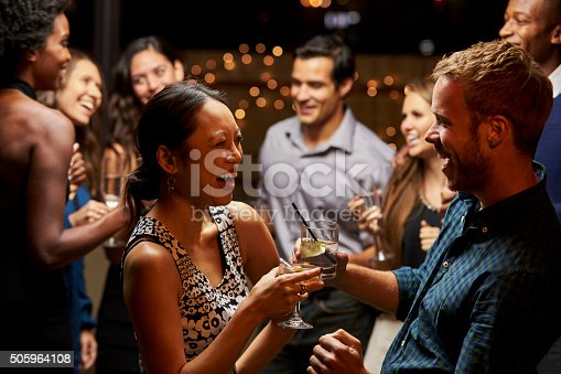 istock Couples Dancing And Drinking At Evening Party 505964108