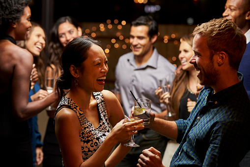 Couples Dancing And Drinking At Evening Party Stock Photo - Download Image Now