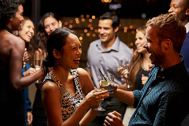 couples dancing and drinking at evening party - happy hour stock photos and pictures