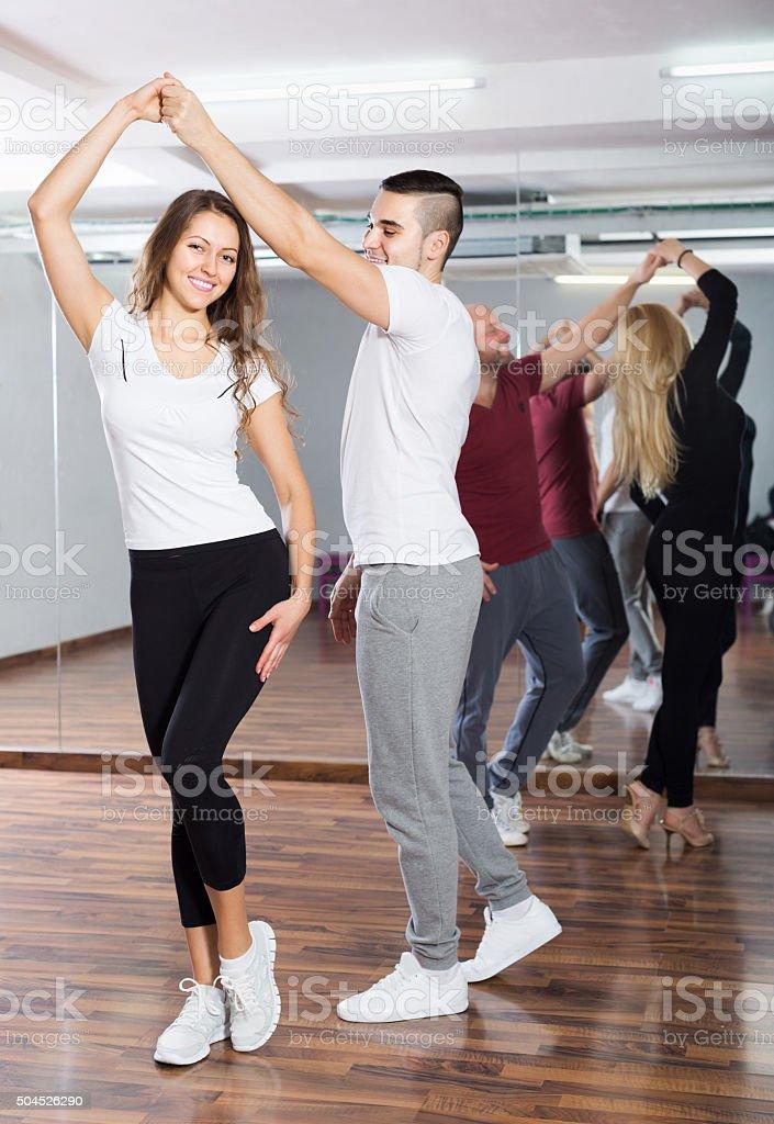 Couples enjoying of partner dance stock photo