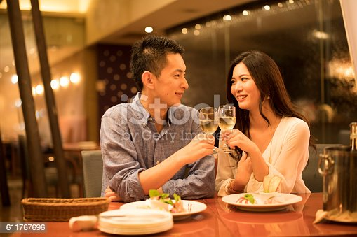 istock Couples have a toast at the restaurant 611767696