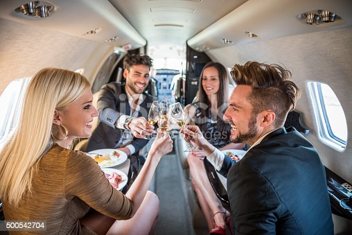 istock Couples having a toast in private jet airplane 500542704