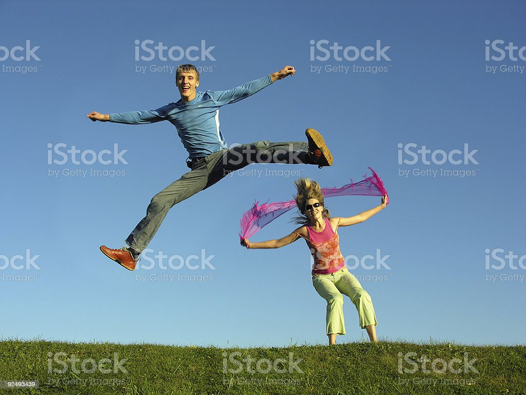 couples jump on grass royalty-free stock photo