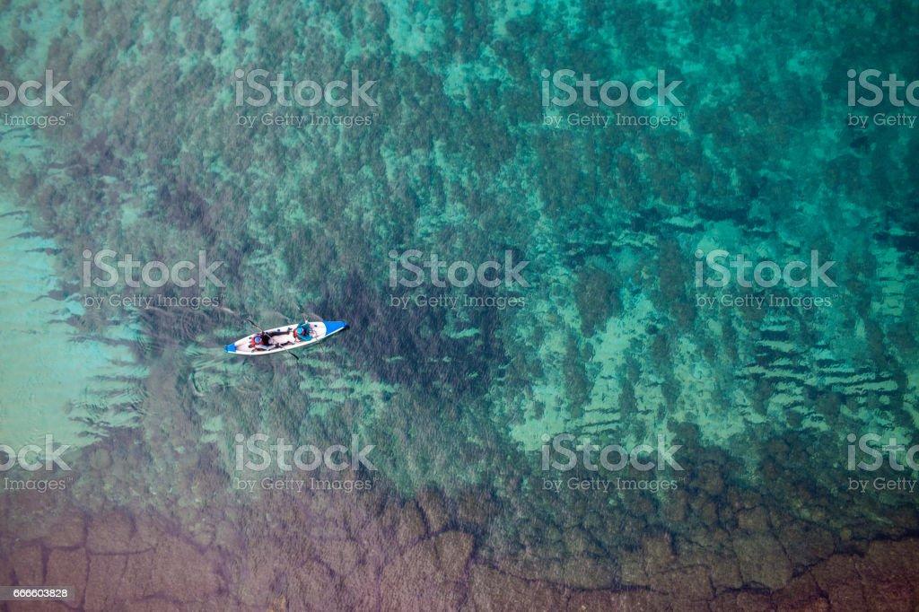 Couple's kayak sea challenge (aerial photography). stock photo