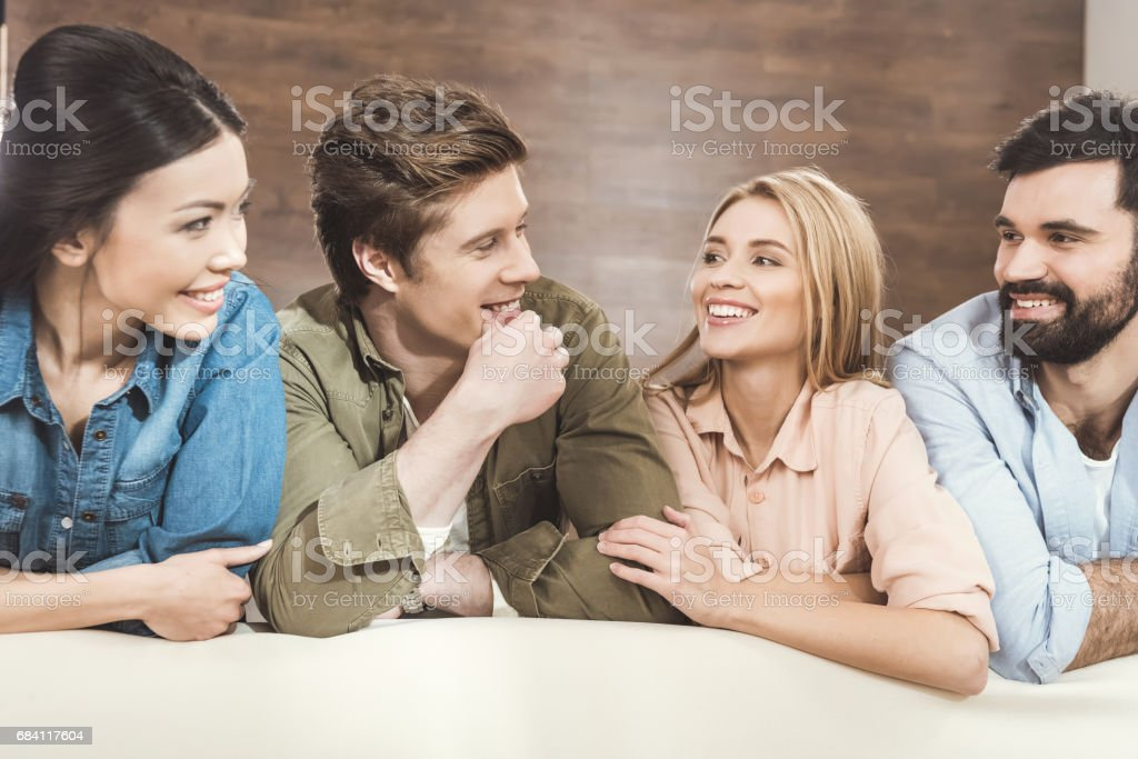 couples leaning on sofa and looking at each other royalty free stockfoto