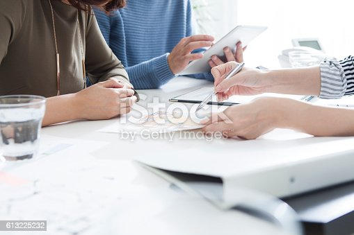 istock Couples looking for a house in a real estate agency. 613225232