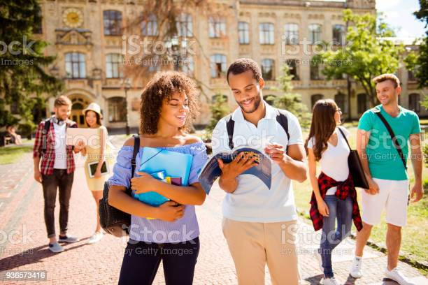 Couples of international students are walking after studies holding picture id936573416?b=1&k=6&m=936573416&s=612x612&h=cdeb3sbtxdfeoykuaemvwry1heezak4amaz3xsgby14=