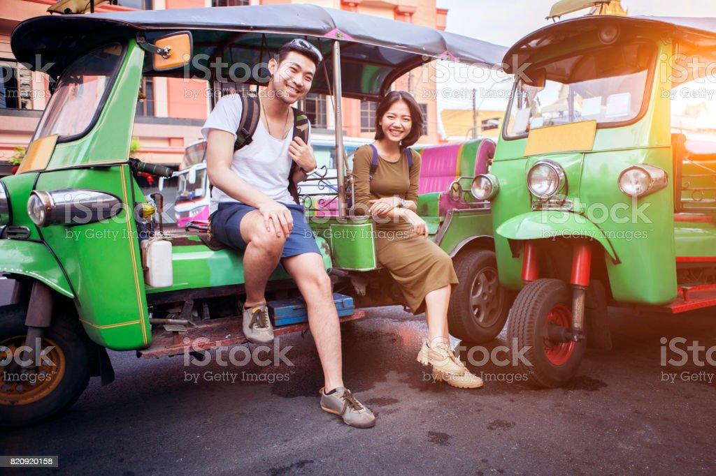Couples of young traveling people sitting on tuk tuk bangkok thailand -  Stock image .
