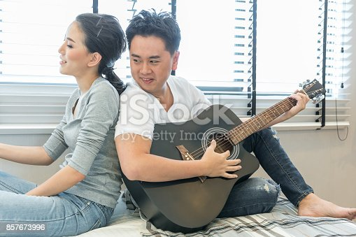 849355030 istock photo Couples playing guitar 857673996