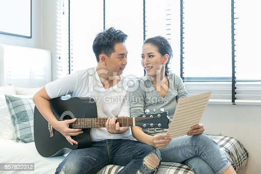849355030 istock photo Couples playing guitar 857822012