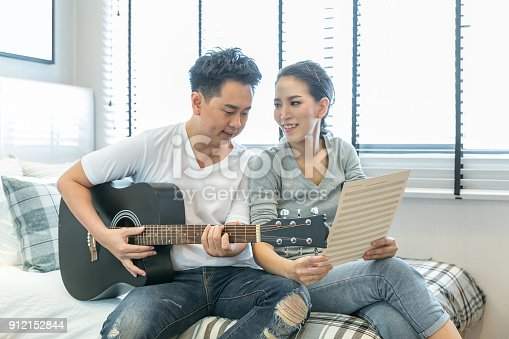 849355030 istock photo Couples playing guitar 912152844