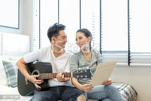 849355030 istock photo Couples playing guitar 937791090