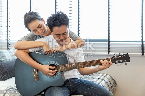 849355030 istock photo Couples playing guitar 937791160