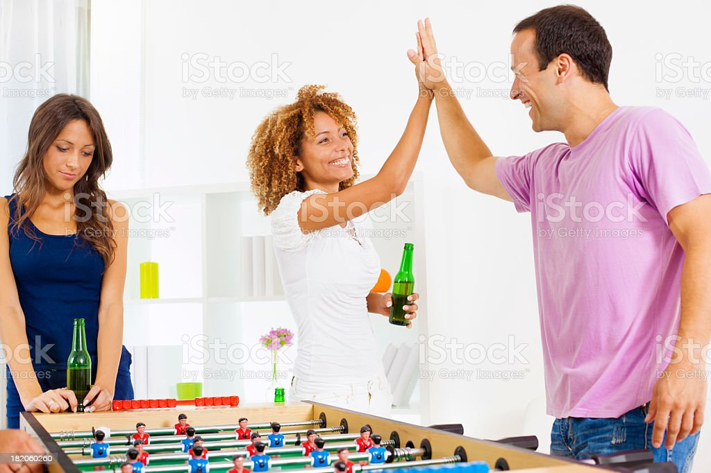 Couples Playing Table Foosball. stock photo
