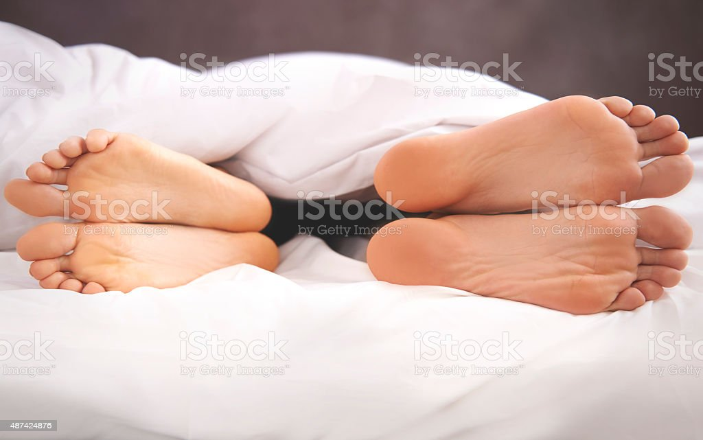 Couple's problems in the bed stock photo