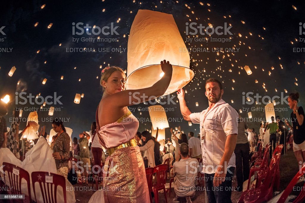 Couples releasing lanterns in the sky during Yi Peng festival, Thailand stock photo