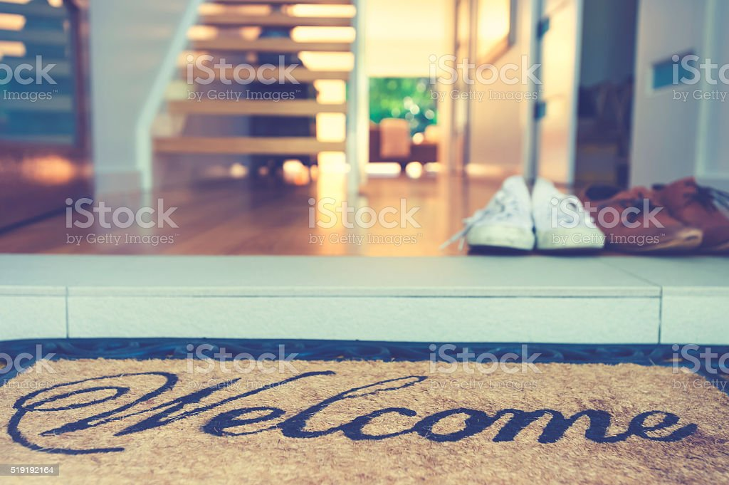 Couples shoes at the front door of a house. stock photo