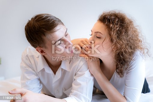 950598260 istock photo Couples teasing in the romantic atmosphere on the bed, Valentines Day concept. 1190687320