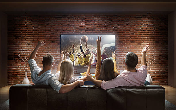 Couples watching Basketball game at home - Photo