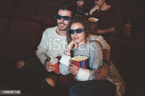 187095683 istock photo Couples watching movie in the cinema 1068467190