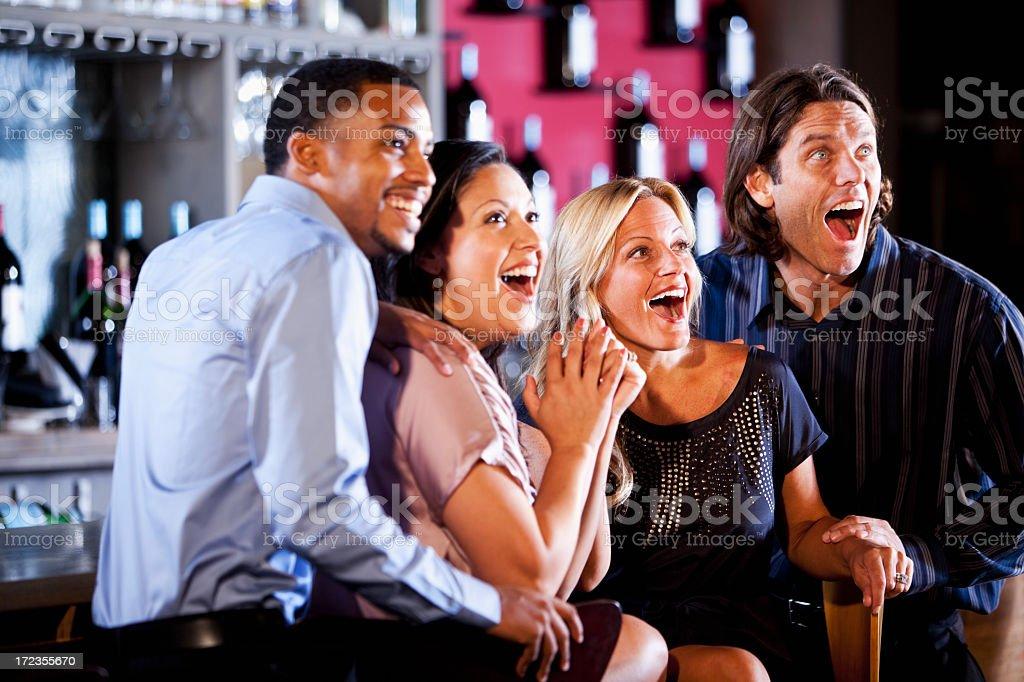 Couples watching sports at bar royalty-free stock photo