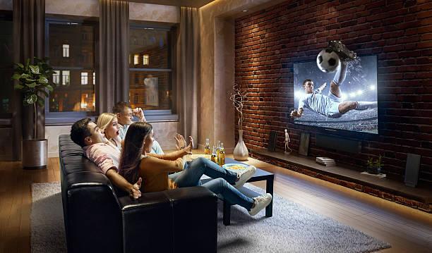couples watching very realistic soccer game on tv - fußball themenzimmer stock-fotos und bilder