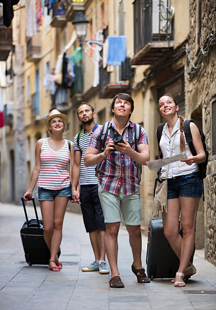 Couples with baggage walking the city stock photo