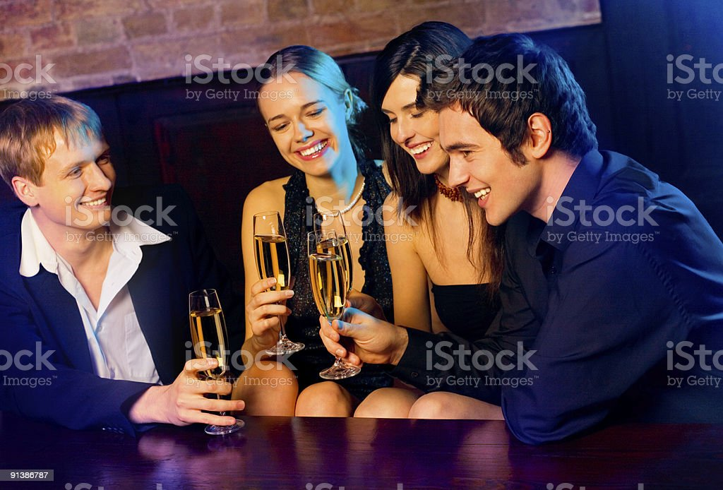 Couples with champagne glasses at celebration royalty-free stock photo