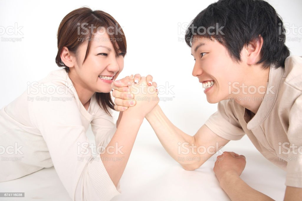 Couples wrestling royalty-free stock photo