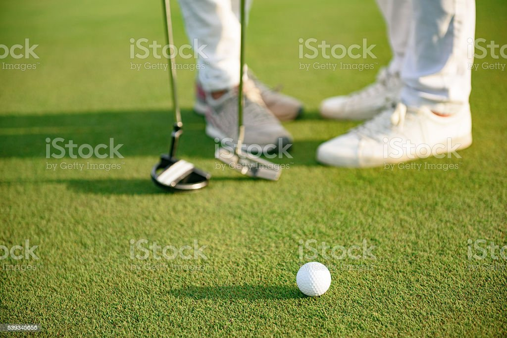 Couplestaing on golf course stock photo