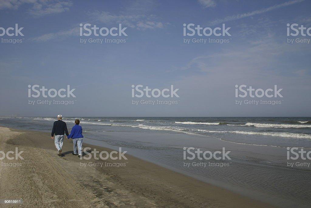 CoupleWalkingOnBeach royalty-free stock photo