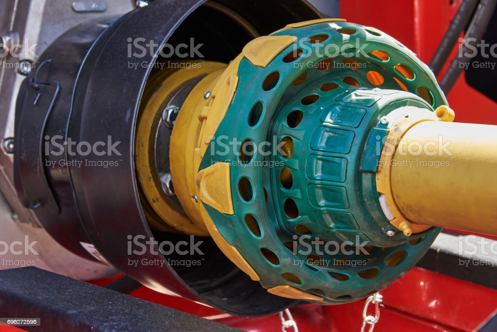 Coupling for transfer of mechanical energy from the tractor motor to the attached equipment stock photo