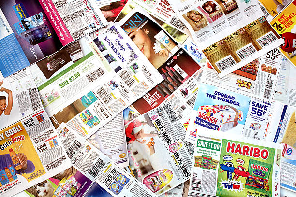 Coupon Pile Colorado, USA - July 13, 2016: Studio shot of a pile of manufacturer coupons. inserting stock pictures, royalty-free photos & images