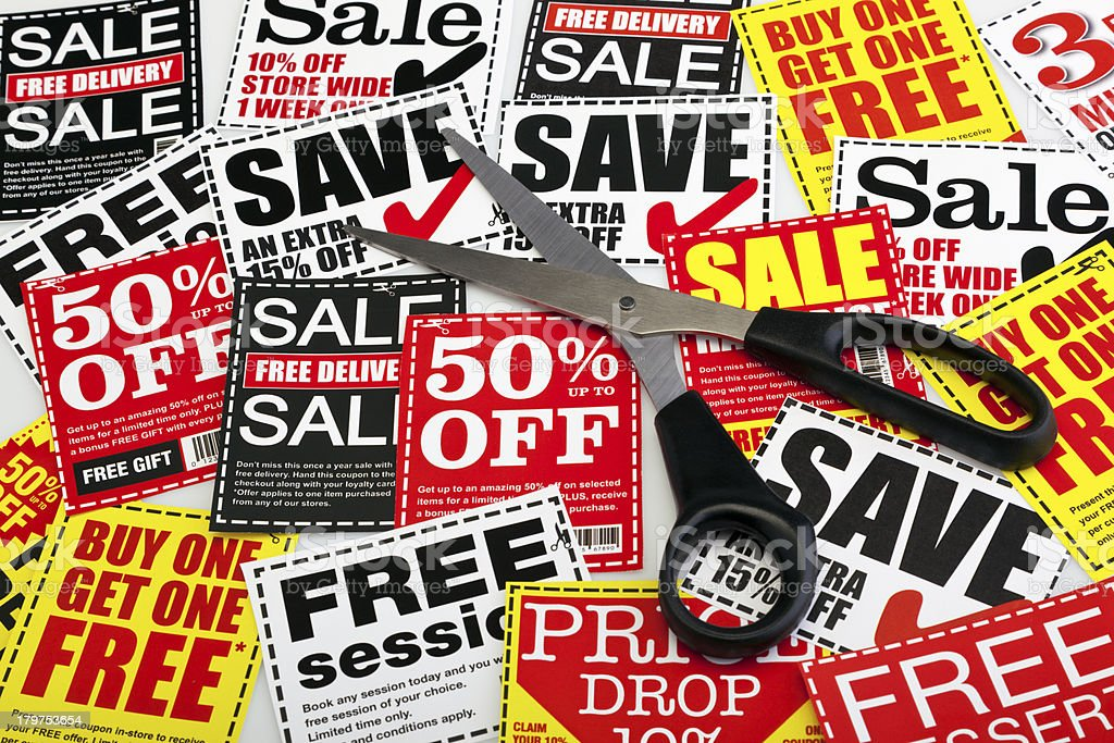 Coupon vouchers with scissors stock photo