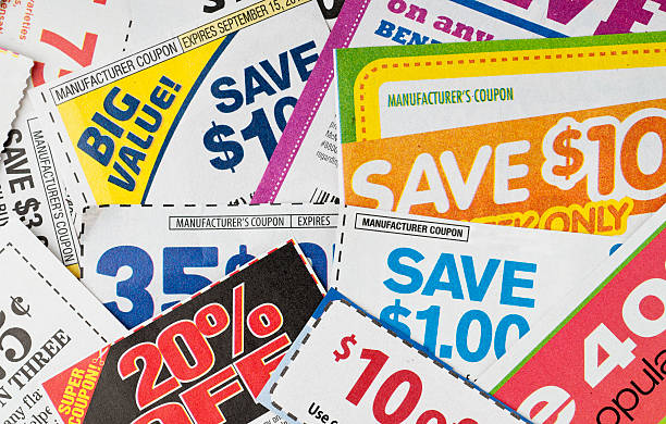 Coupons Large stack of money saving coupons. miserly stock pictures, royalty-free photos & images