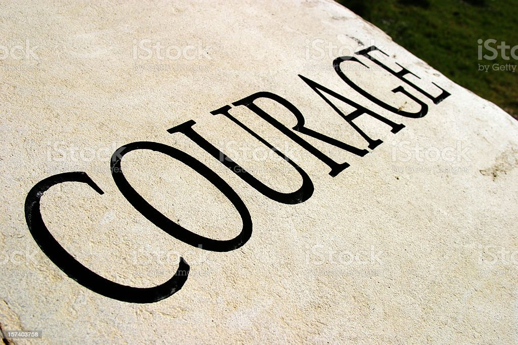 Courage written in a large font in all capital letters royalty-free stock photo