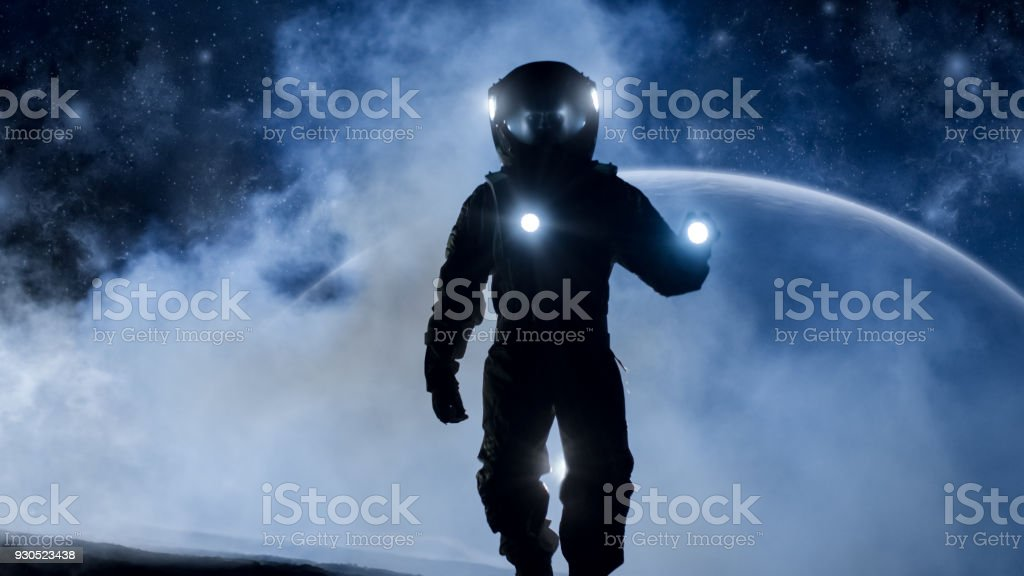 Courageous Astronaut In The Space Suit Holds Flashlight And