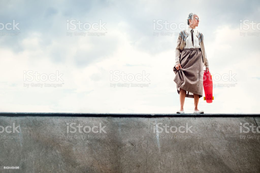 Courageous Grandma Skateboarding stock photo