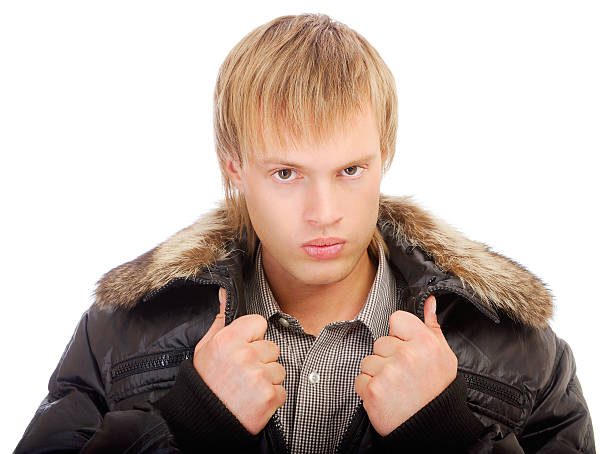 Courageous man in winter jacket stock photo