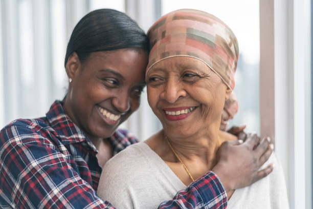 courageous woman with cancer spends precious time with adult daughter - cancer patient stock pictures, royalty-free photos & images