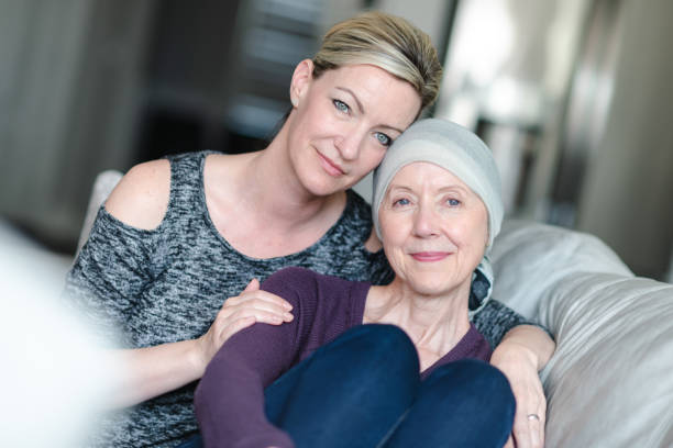 Courageous woman with cancer spends precious time with adult daughter stock photo