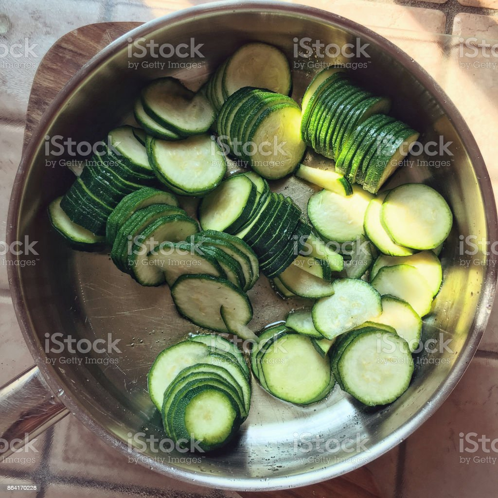 Courgettes in a frypan stock photo