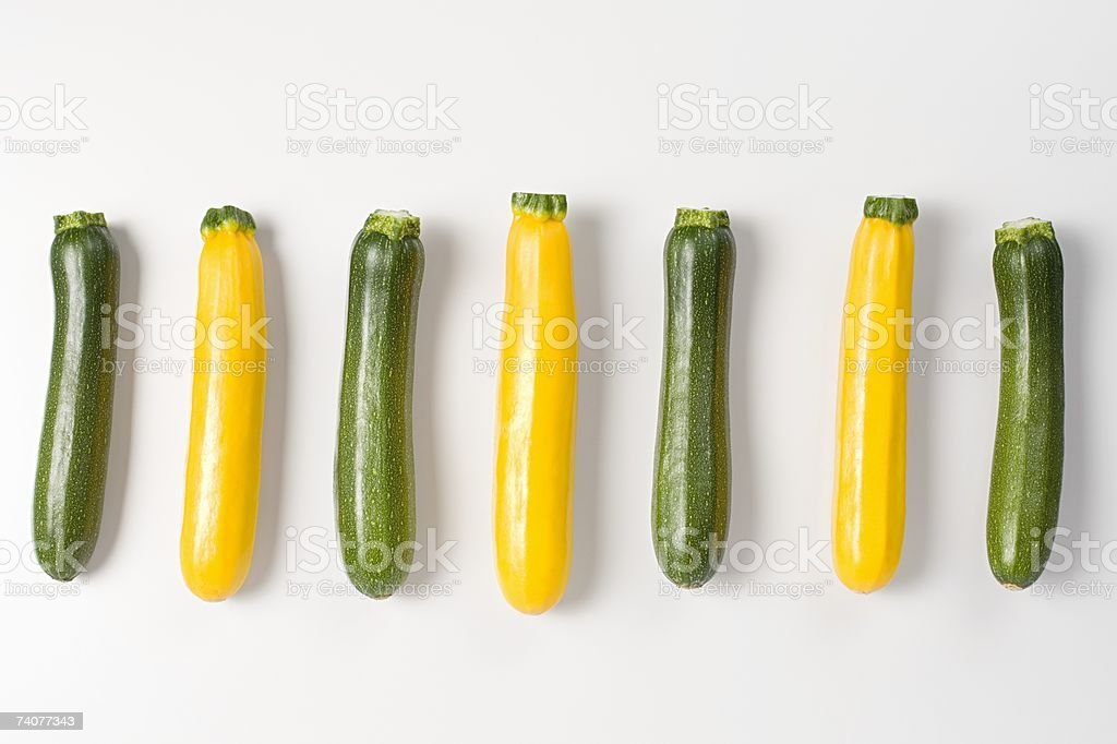 Courgettes in a row stock photo