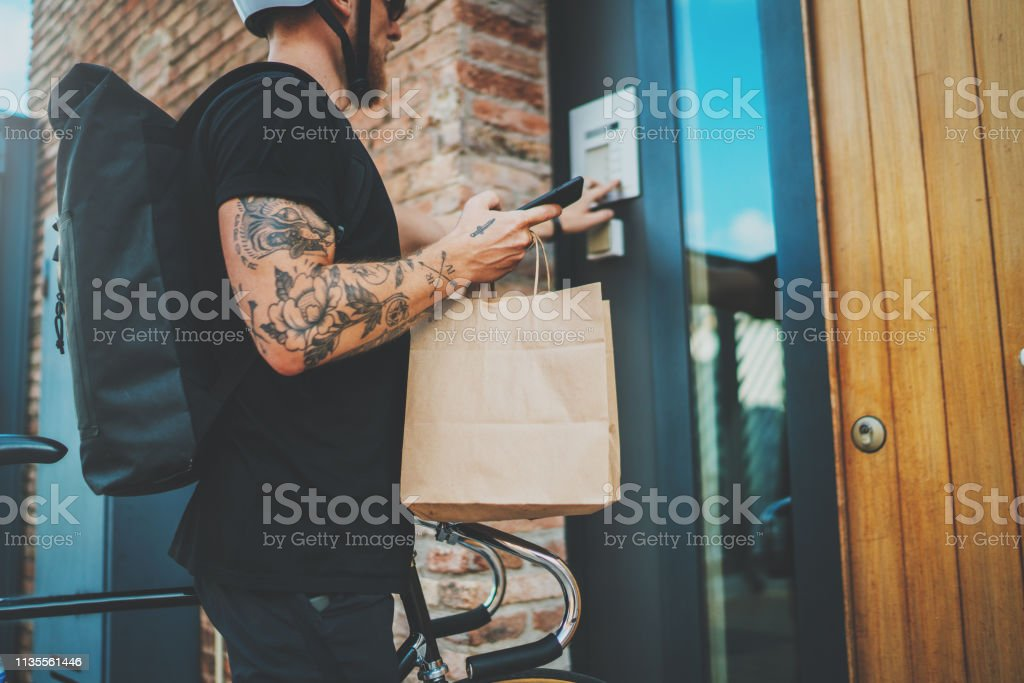 Courier City Delivery Food Service At Home Tattooed Man